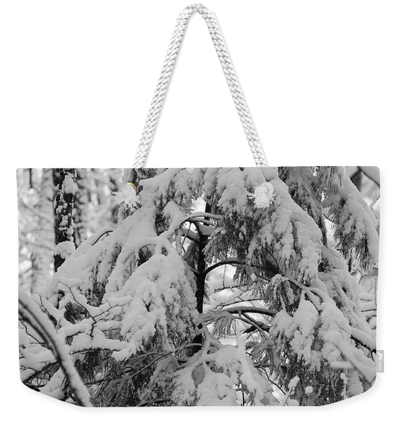 Snow Weekender Tote Bag featuring the photograph Heavy Burden by Eric Liller