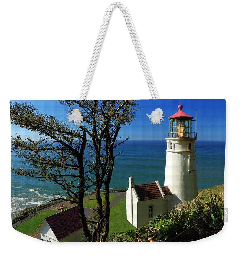Lighthouse Weekender Tote Bag featuring the photograph Heceta Head Lighthouse by James Eddy