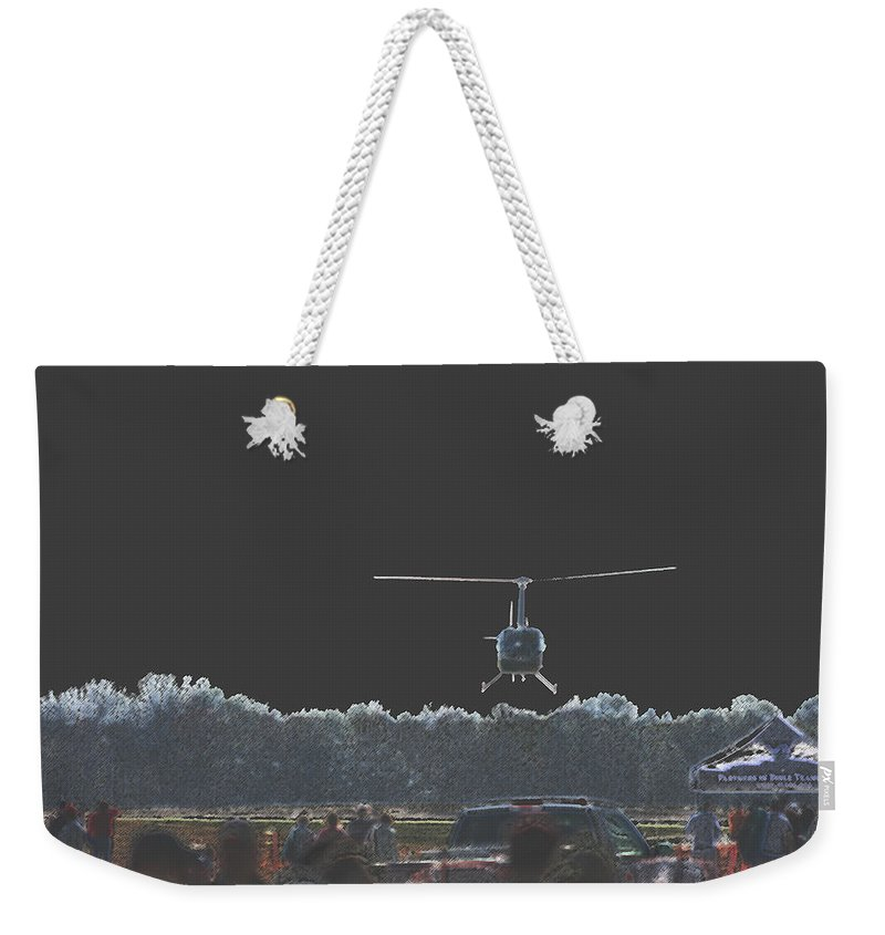 Military Weekender Tote Bag featuring the photograph Helicopter Lift by Karol Livote