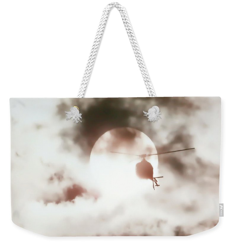 Helicopter Weekender Tote Bag featuring the photograph Helicopter Silhouette by Athena Mckinzie