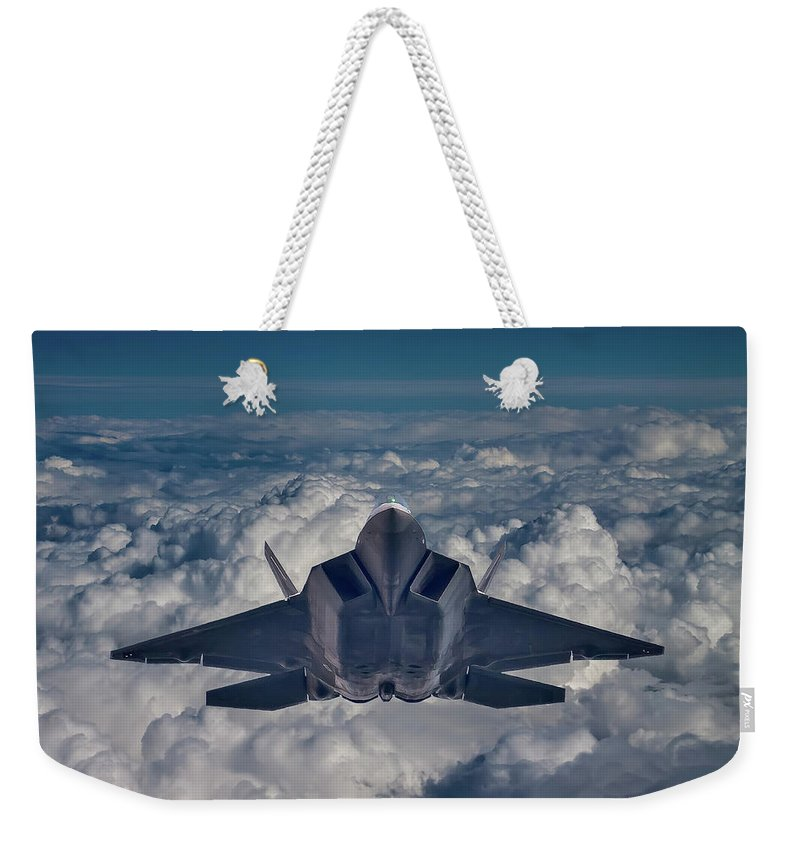 Clouds Weekender Tote Bag featuring the photograph Here Comes The Raptor by Bill Lindsay