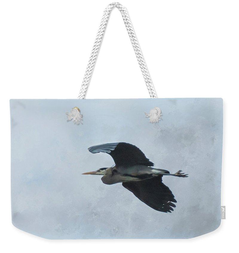 Heron Weekender Tote Bag featuring the photograph Heron In Flight by Marilyn Wilson
