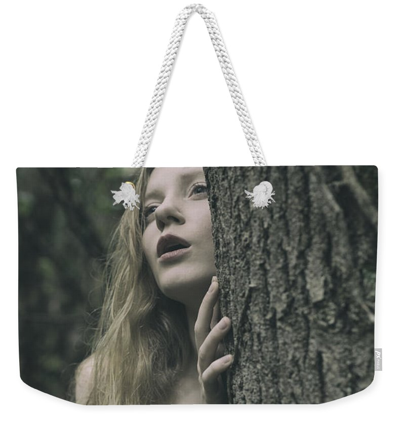 Woman Weekender Tote Bag featuring the photograph Hiding by Clayton Bastiani
