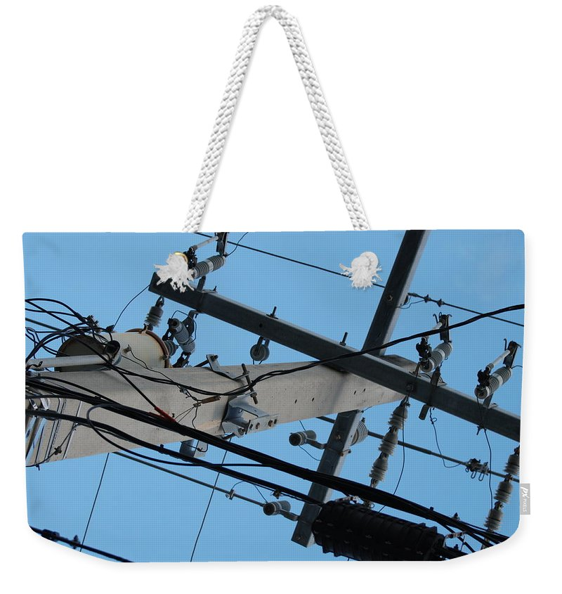 Sky Weekender Tote Bag featuring the photograph High Wire by Rob Hans