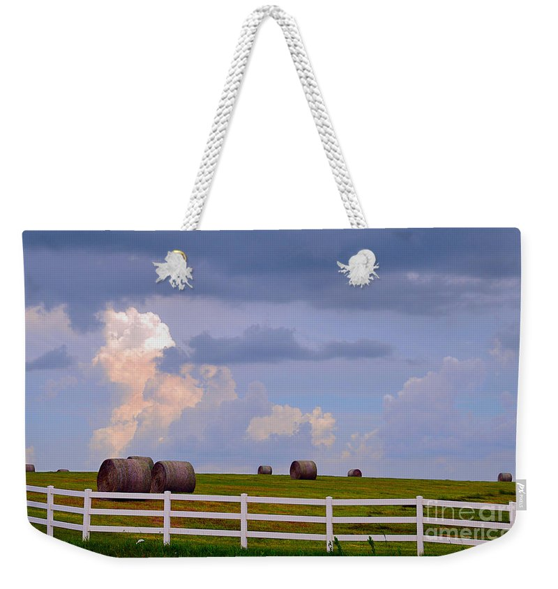 Hay Bales Weekender Tote Bag featuring the photograph Hillside Hay Bales At Sunset by Catherine Sherman