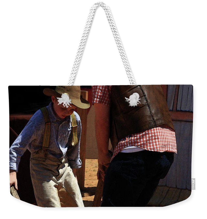 Western Weekender Tote Bag featuring the photograph Hit The Can by Kim Henderson
