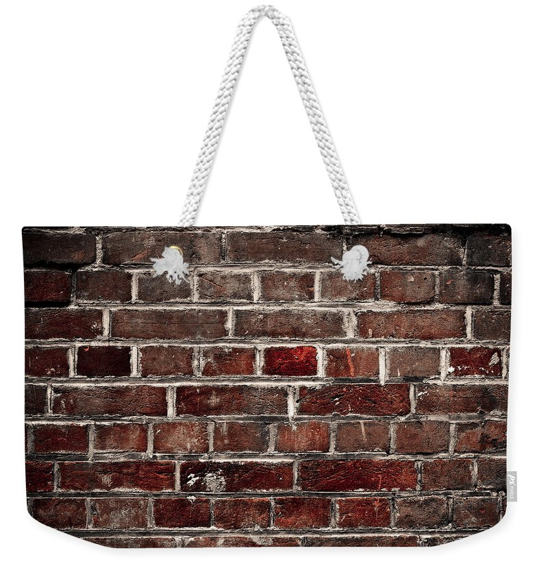 Wall Weekender Tote Bag featuring the photograph Hit The Wall by Kelly Jade King