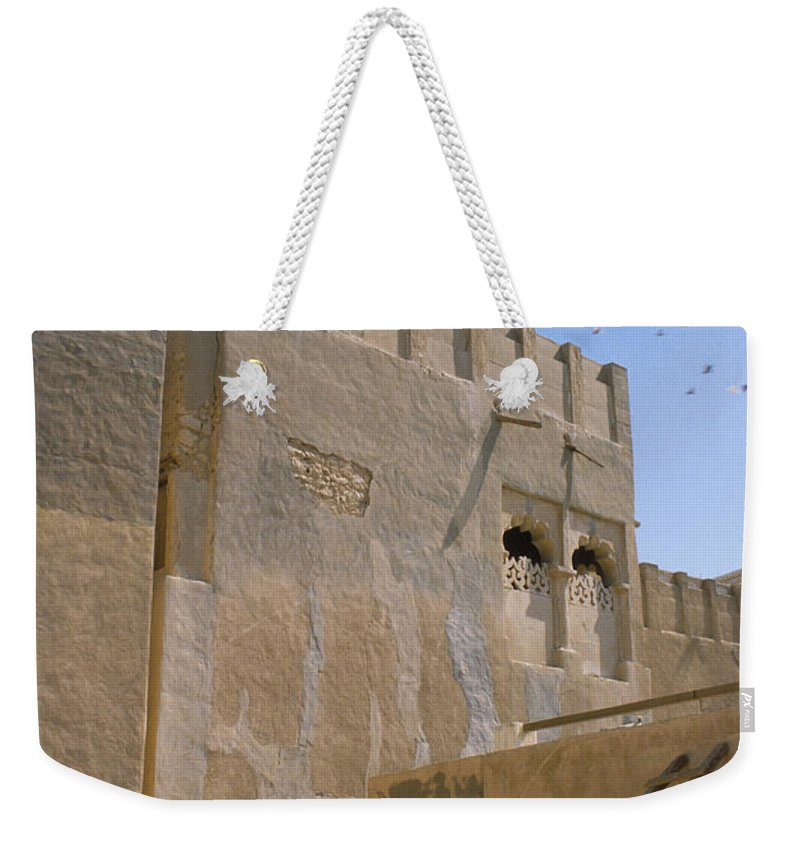 Hofuf Weekender Tote Bag featuring the photograph Hofuf Alley by Jerry McElroy