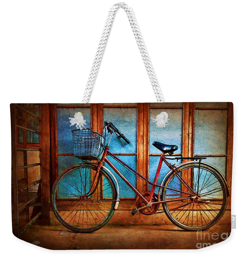 Hoi An Weekender Tote Bag featuring the photograph Hoi An Bike by Stuart Row