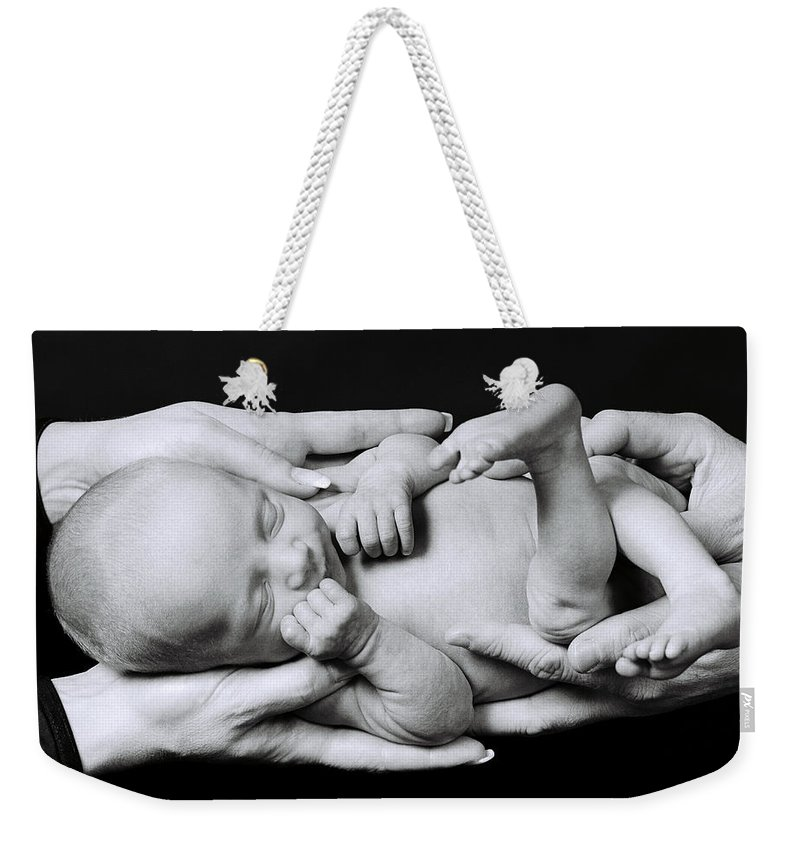 Infant Weekender Tote Bag featuring the photograph Holding On by Herman Robert