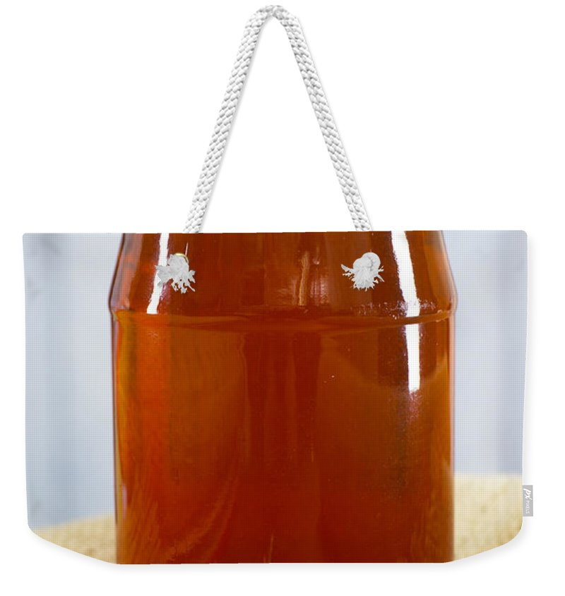 Honey Weekender Tote Bag featuring the photograph Honey In Clear Glass Jar by Donald Erickson