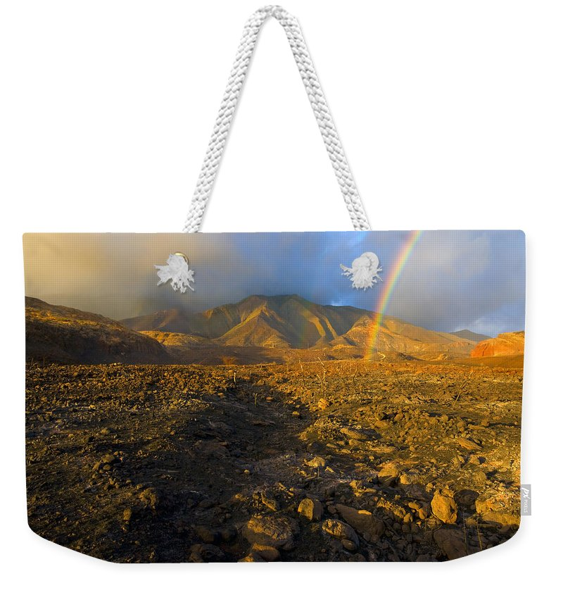 Rainbow Weekender Tote Bag featuring the photograph Hope From Desolation by Mike Dawson