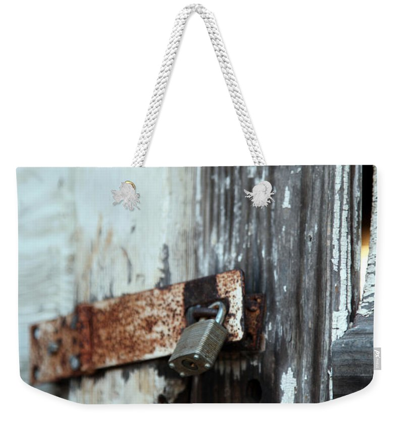 hopelessly Locked Weekender Tote Bag featuring the photograph Hopelessly Locked by Amanda Barcon