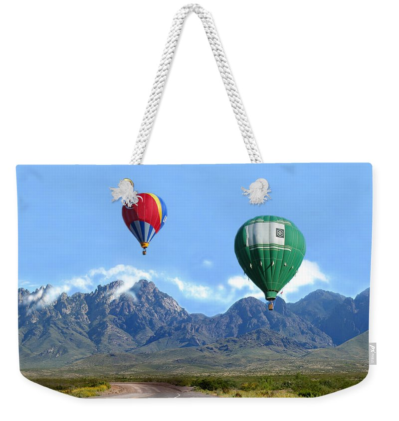 Organ Mountains-desert Peaks National Monument Weekender Tote Bag featuring the photograph Hot Air Over The Organ Mountains by Jack Pumphrey