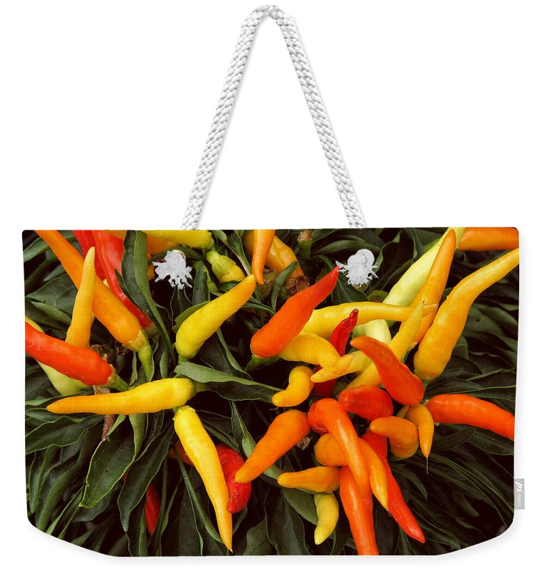 Peppers Weekender Tote Bag featuring the photograph Hot by Peg Urban