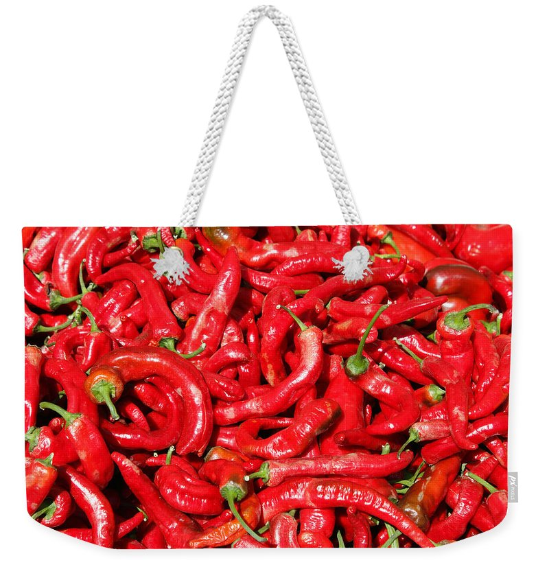 Hot Weekender Tote Bag featuring the photograph Hot Red Peppers In The Summer Sun by Lee Serenethos