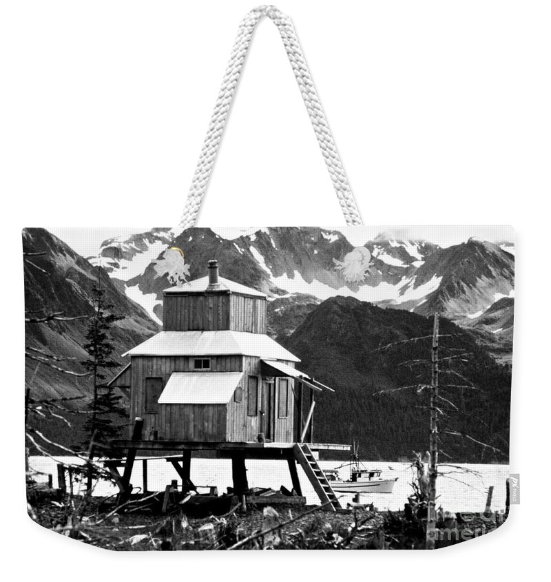 Alaska Weekender Tote Bag featuring the photograph House Of Stilts Bw by James BO Insogna