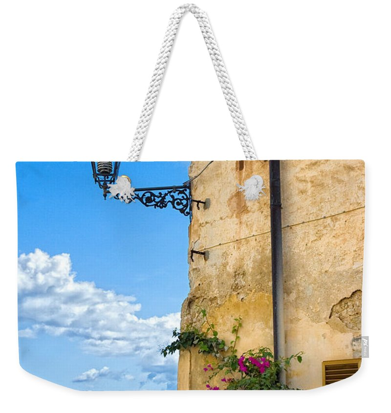 Architecture Weekender Tote Bag featuring the photograph House With Bougainvillea Street Lamp And Distant Sea by Silvia Ganora