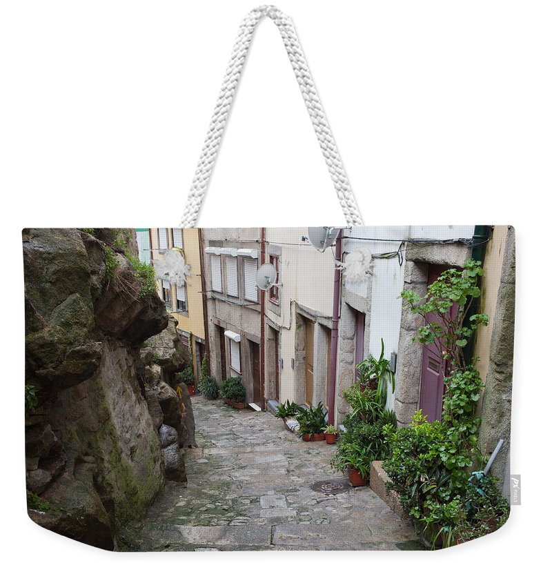 Porto Weekender Tote Bag featuring the photograph Houses Along Alley In The Old Town Of Porto by Artur Bogacki