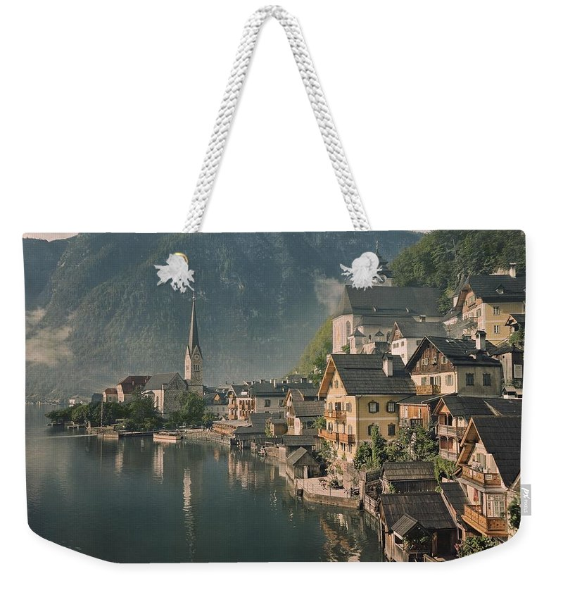 Color Image Weekender Tote Bag featuring the photograph Houses Line The Lake Of Hallstatt by W. Robert Moore