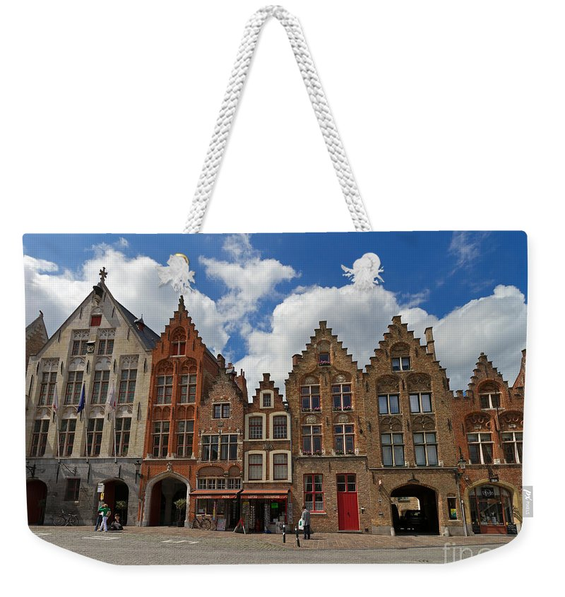 Old Tollhouse Weekender Tote Bag featuring the photograph Houses Of Jan Van Eyck Square In Bruges Belgium by Louise Heusinkveld