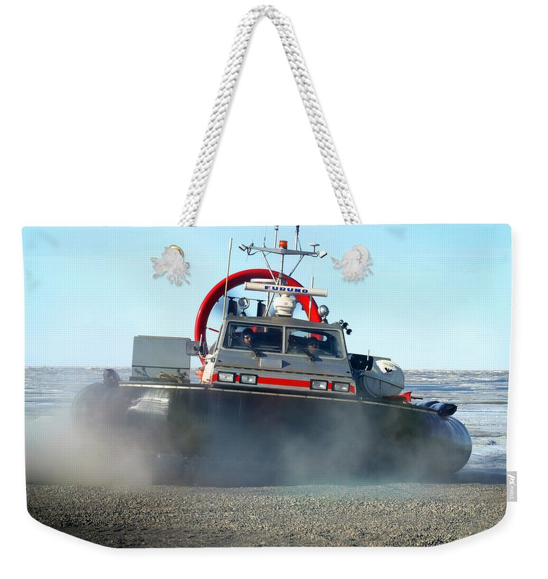 Hover Craft Weekender Tote Bag featuring the photograph Hover Craft by Anthony Jones