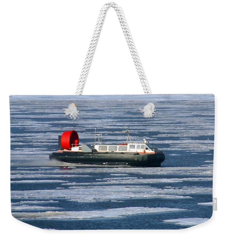 Arctic Ocean Weekender Tote Bag featuring the photograph Hovercraft On Frozen Artic Ocean by Anthony Jones