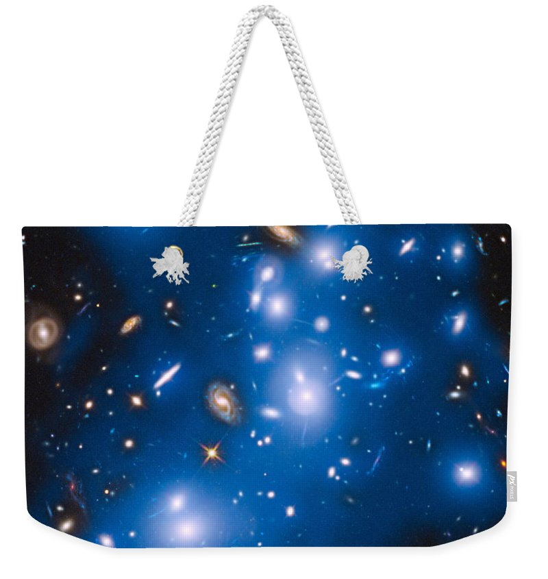 Space Weekender Tote Bag featuring the photograph Hubble Sees Ghost Light From Dead Galaxies by Nasa