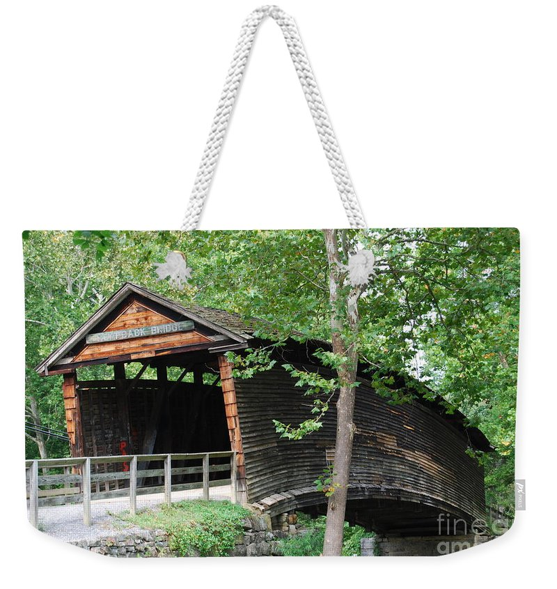 Rock Weekender Tote Bag featuring the photograph Humpback Bridge by Eric Liller