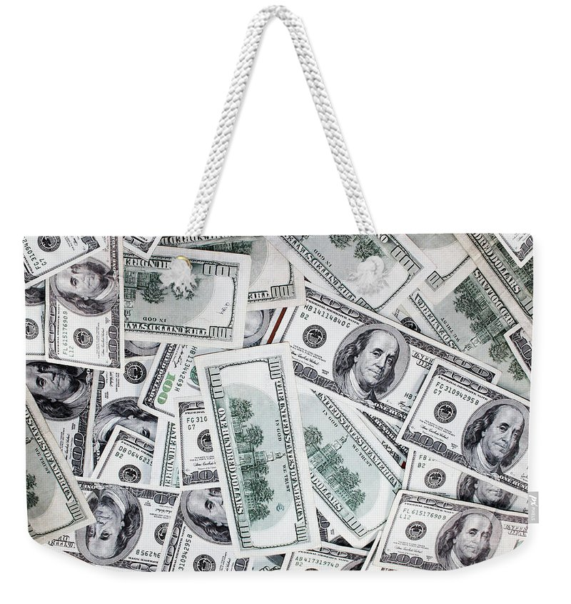 Cash Weekender Tote Bag featuring the photograph Hundred Dollar Bills by Gravityx9 Designs
