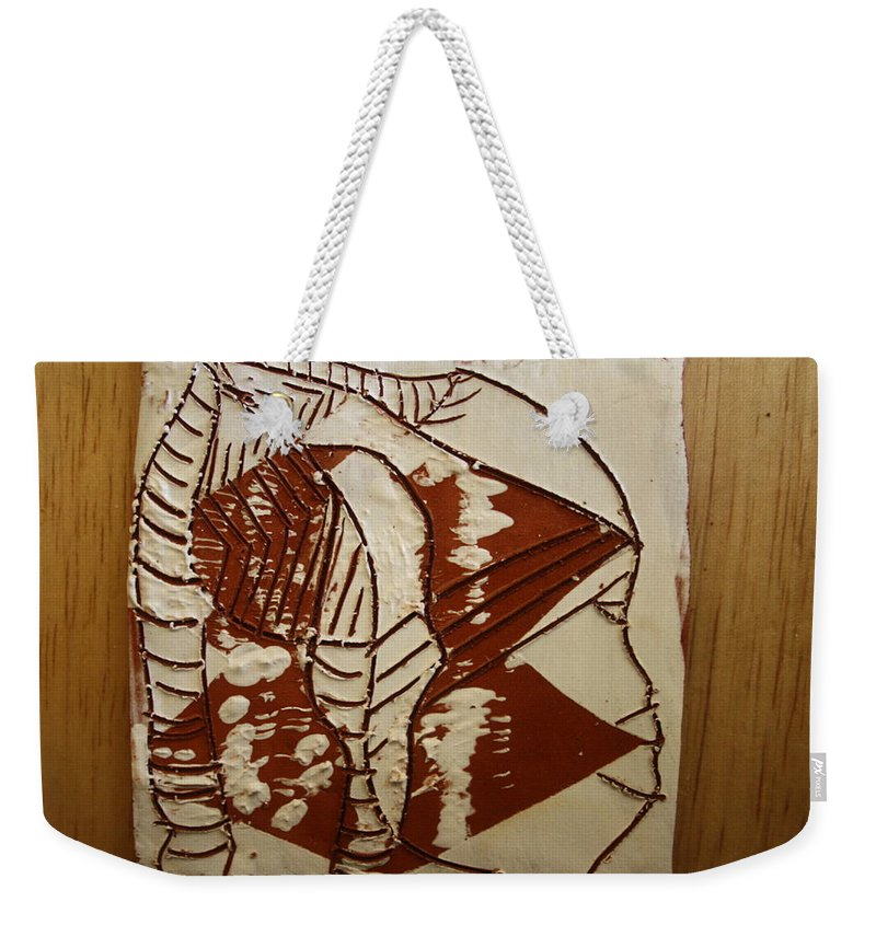 Jesus Weekender Tote Bag featuring the ceramic art Hunter - Tile by Gloria Ssali