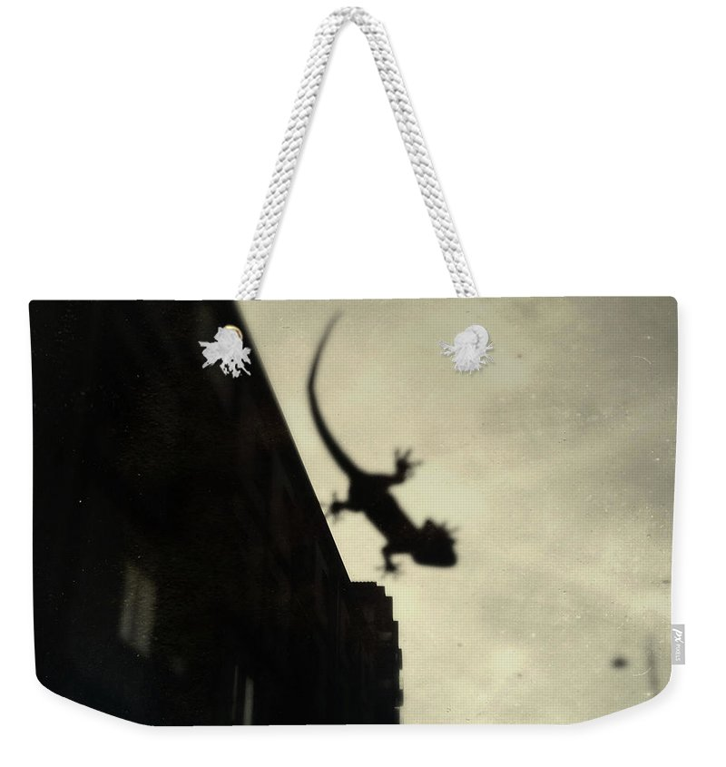 Weekender Tote Bag featuring the pyrography I Shot #8 by Marcello Di Donato