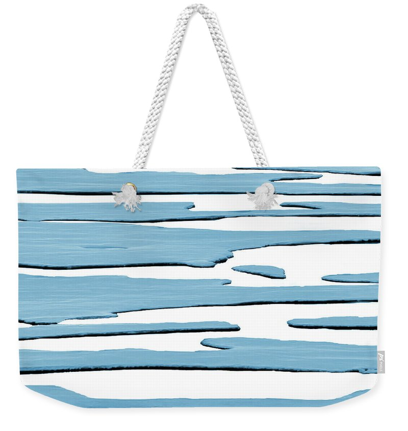 Ice Weekender Tote Bag featuring the photograph Ice Flow by Andrea Kollo