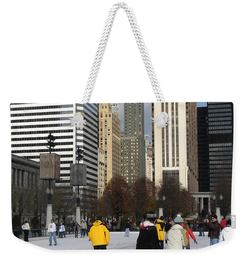 Cityscene Weekender Tote Bag featuring the photograph Ice Skating In The Park by Jan Gilmore