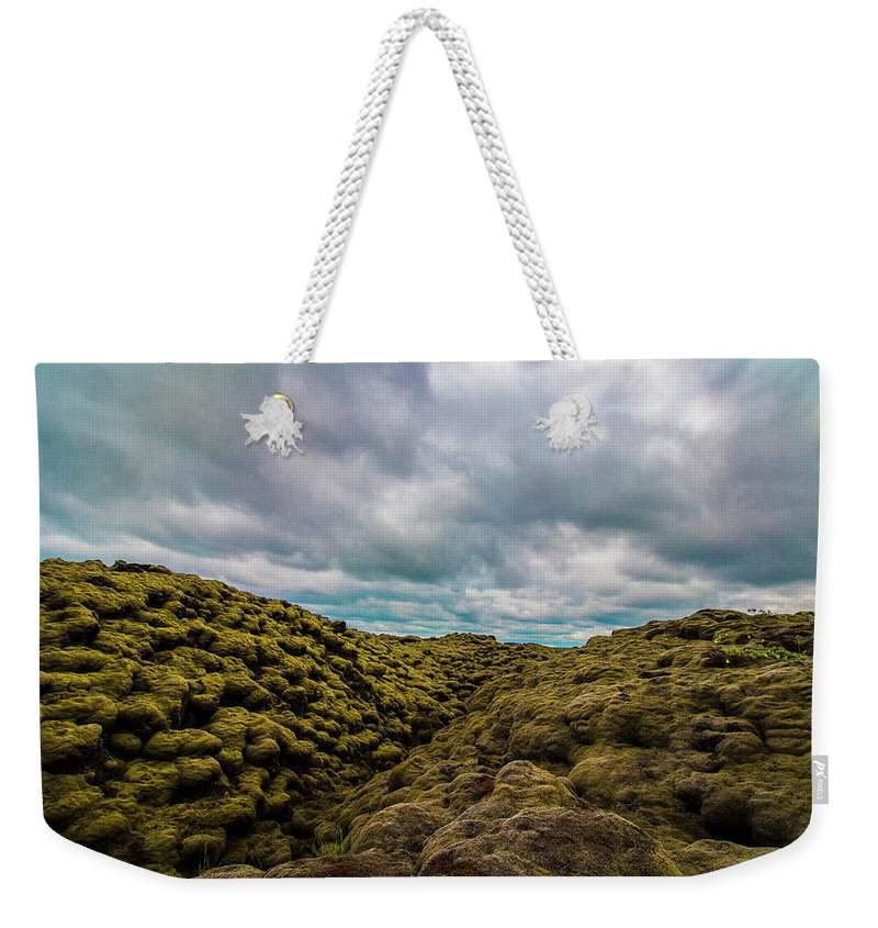 Landscape Weekender Tote Bag featuring the photograph Iceland Moss And Clouds by Venetia Featherstone-Witty
