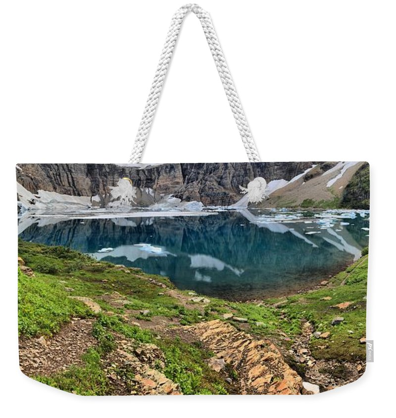 Iceberg Lake Glacier Weekender Tote Bag featuring the photograph Icy Blue And Lush Green by Adam Jewell