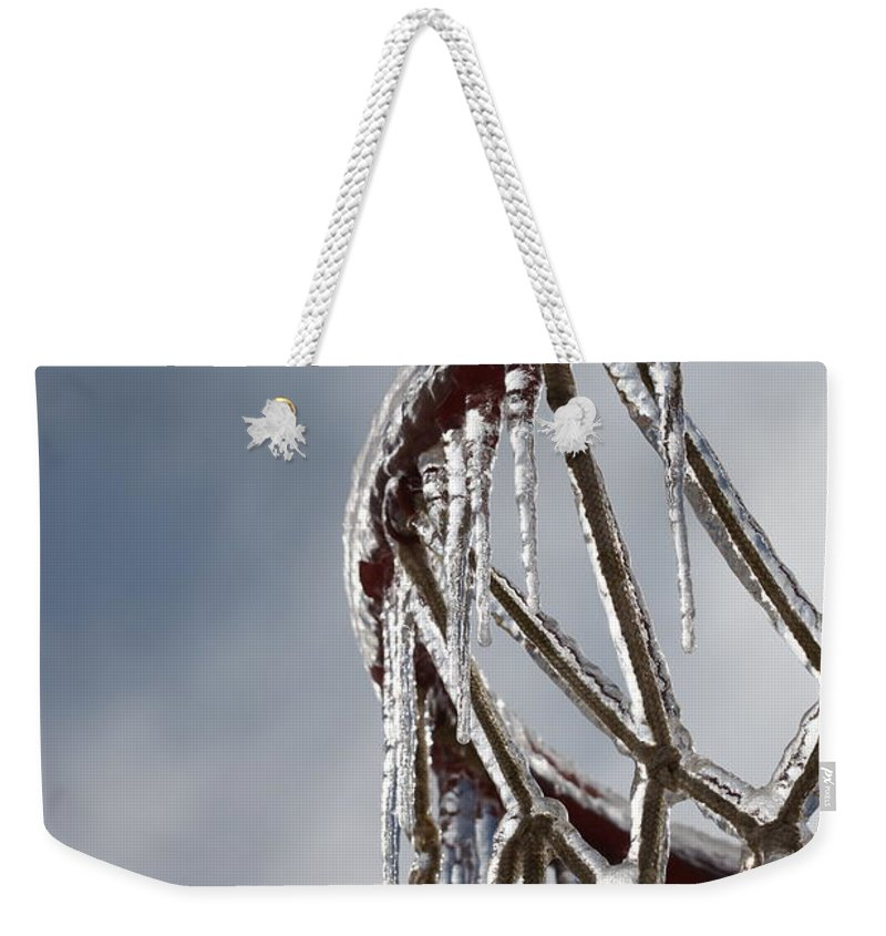 Basketball Weekender Tote Bag featuring the photograph Icy Hoops by Nadine Rippelmeyer