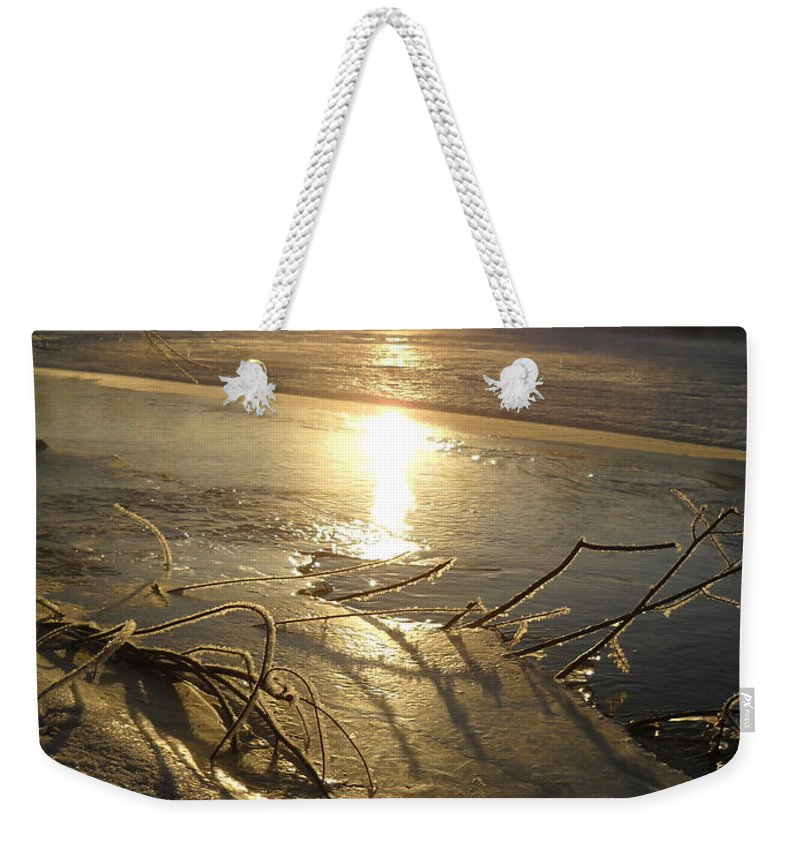 Sunrise Weekender Tote Bag featuring the photograph Icy Mississippi River Bank At Sunrise by Kent Lorentzen