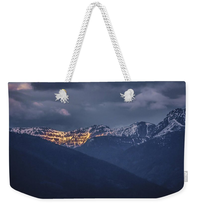 North Idaho Weekender Tote Bag featuring the photograph Illuminating The Scotchmans by Albert Seger