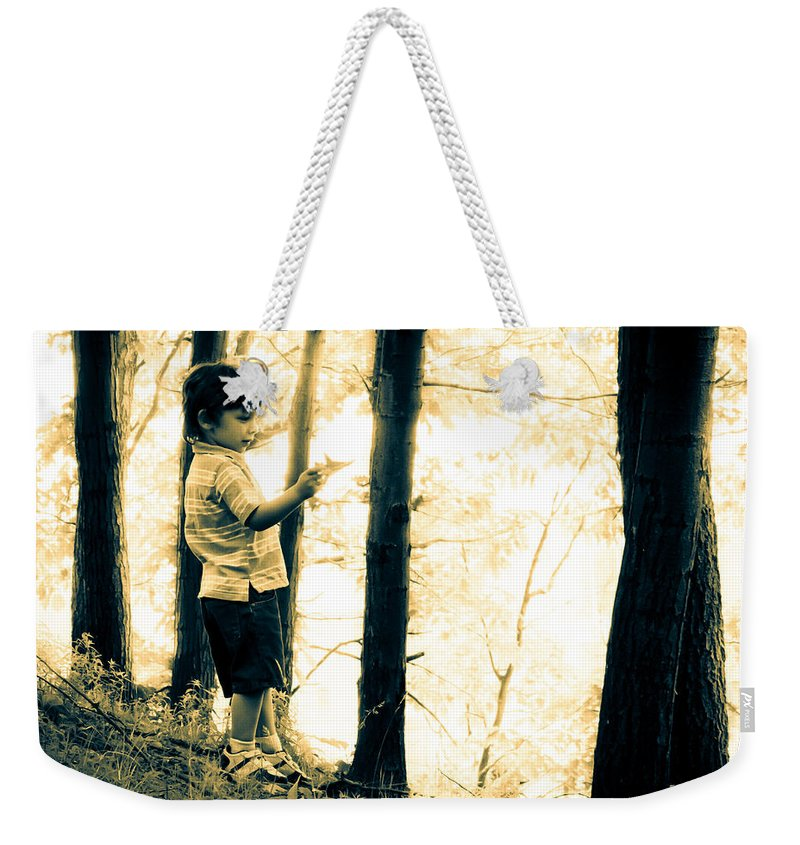 Human Weekender Tote Bag featuring the photograph Imagination And Adventure by Bob Orsillo
