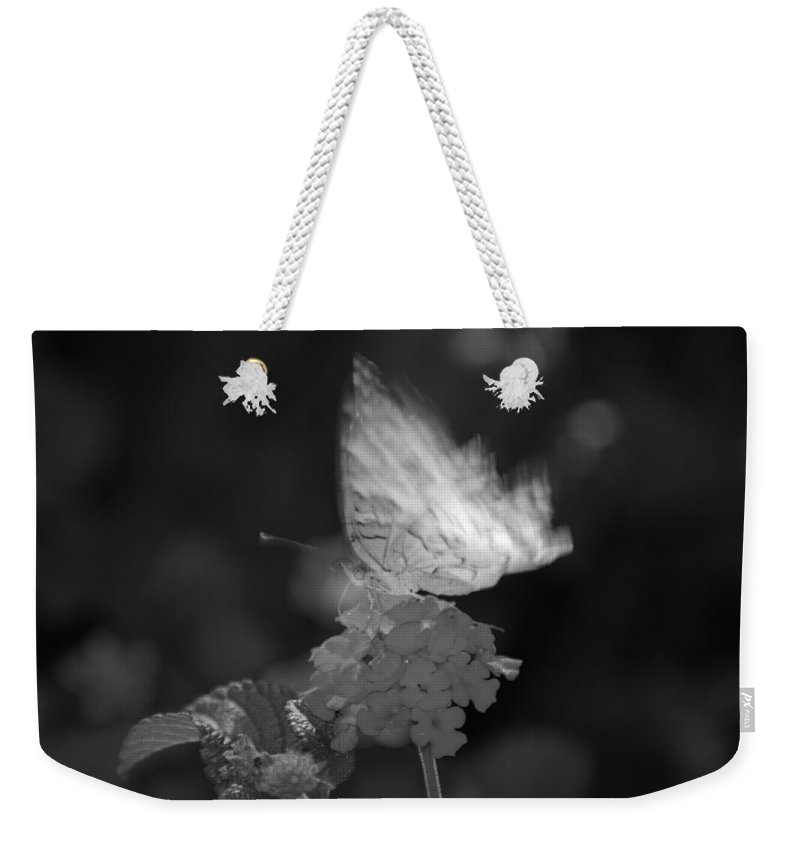 Black And White Weekender Tote Bag featuring the photograph In Motion by Rob Hans