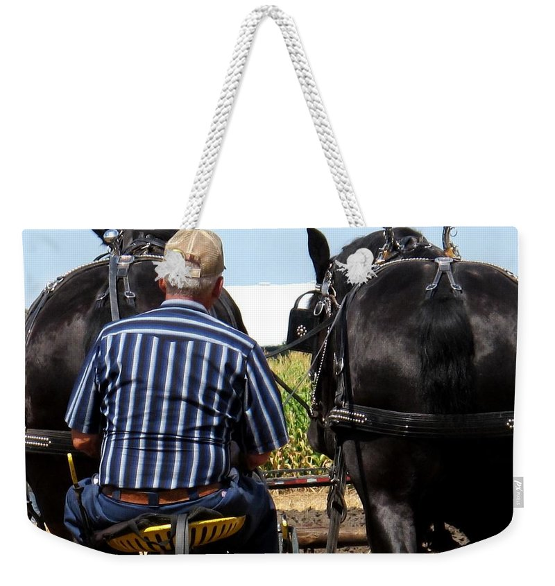 Plow Weekender Tote Bag featuring the photograph In Sync by Ian MacDonald