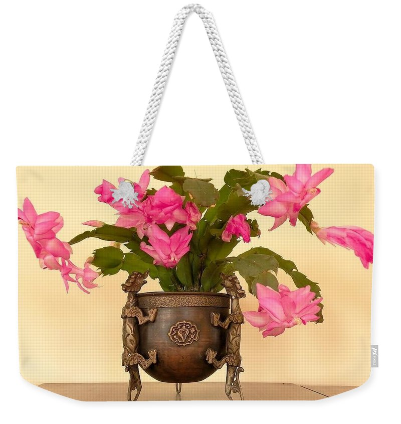Weekender Tote Bag featuring the photograph In The Antique Tibetan Dragon Pot by Kim Bemis