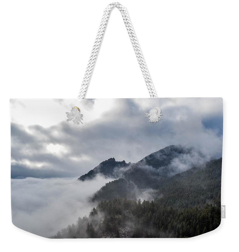 Cloud Weekender Tote Bag featuring the photograph In The Clouds by Michael Putthoff