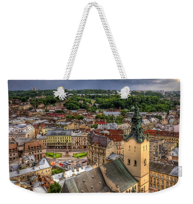 Above Weekender Tote Bag featuring the photograph In The Heart Of The City by Evelina Kremsdorf