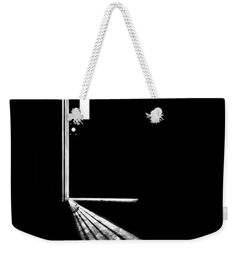 Door Weekender Tote Bag featuring the photograph In The Light Of Darkness by Evelina Kremsdorf