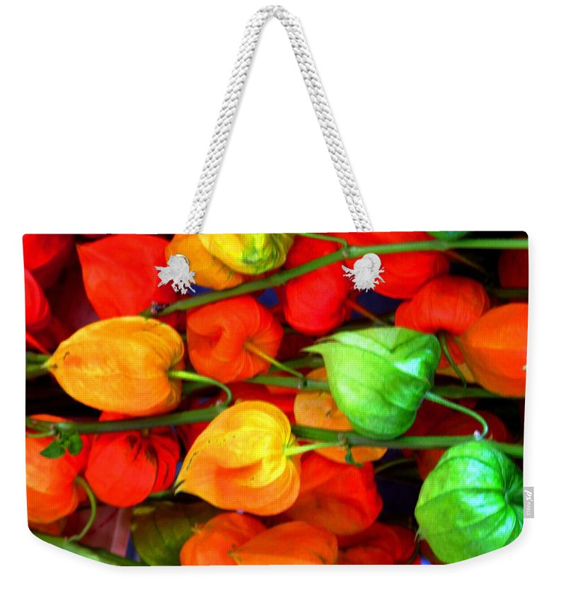 Market Weekender Tote Bag featuring the photograph In The Market by Ian MacDonald