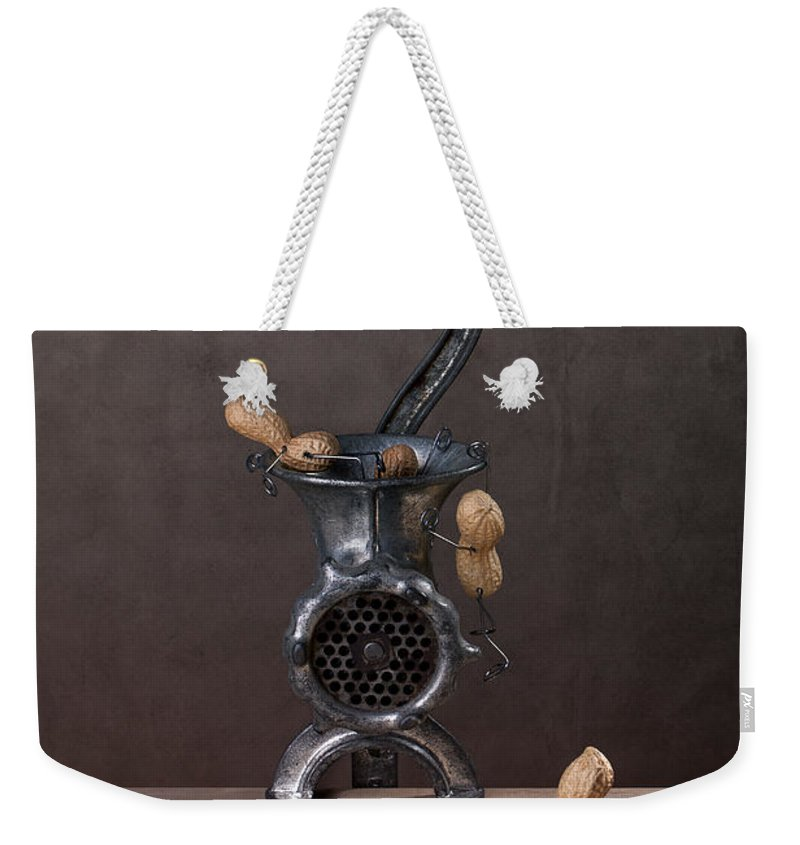 Peanut Weekender Tote Bag featuring the photograph In The Meat Grinder 01 by Nailia Schwarz