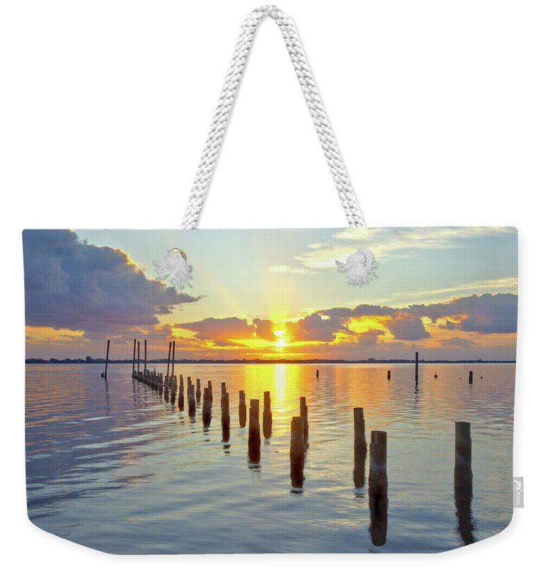 16323 Weekender Tote Bag featuring the photograph Indian River Sunrise by Gordon Elwell