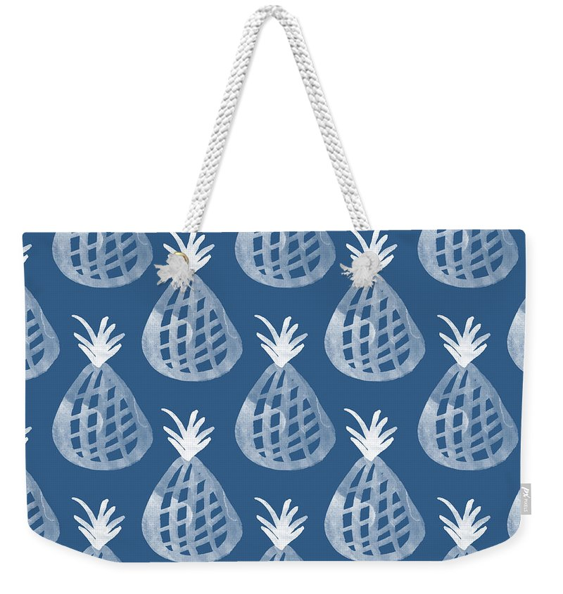 Indigo Weekender Tote Bag featuring the mixed media Indigo Pineapple Party by Linda Woods